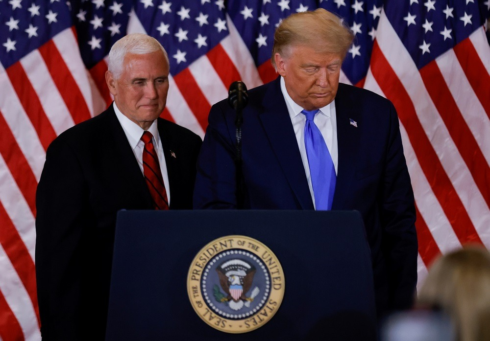 Pence rejects calls to oust defiant Trump, but impeachment looms