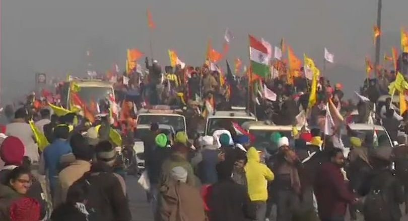 Farmers break police barricade at Tikri border, tractor rally enters Delhi